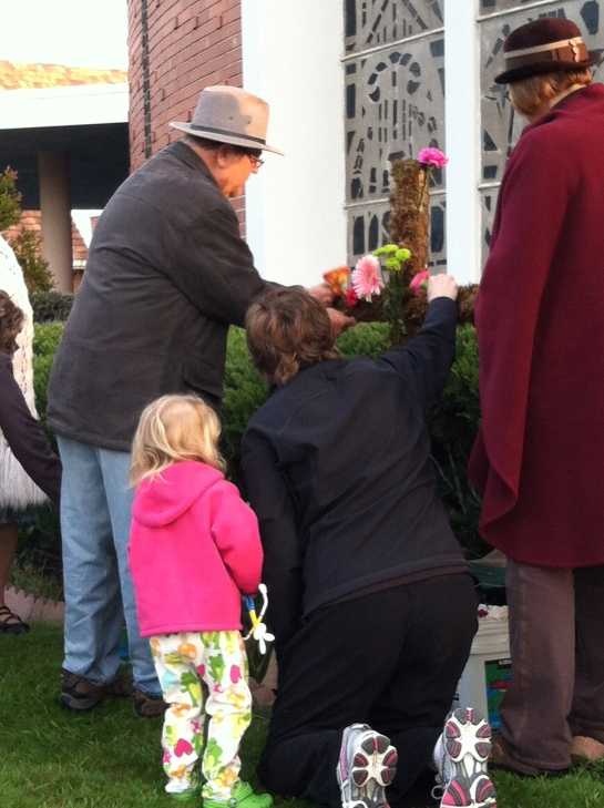 gathering at sunrise on Easter morning and placing fresh flowers into the cross is worship